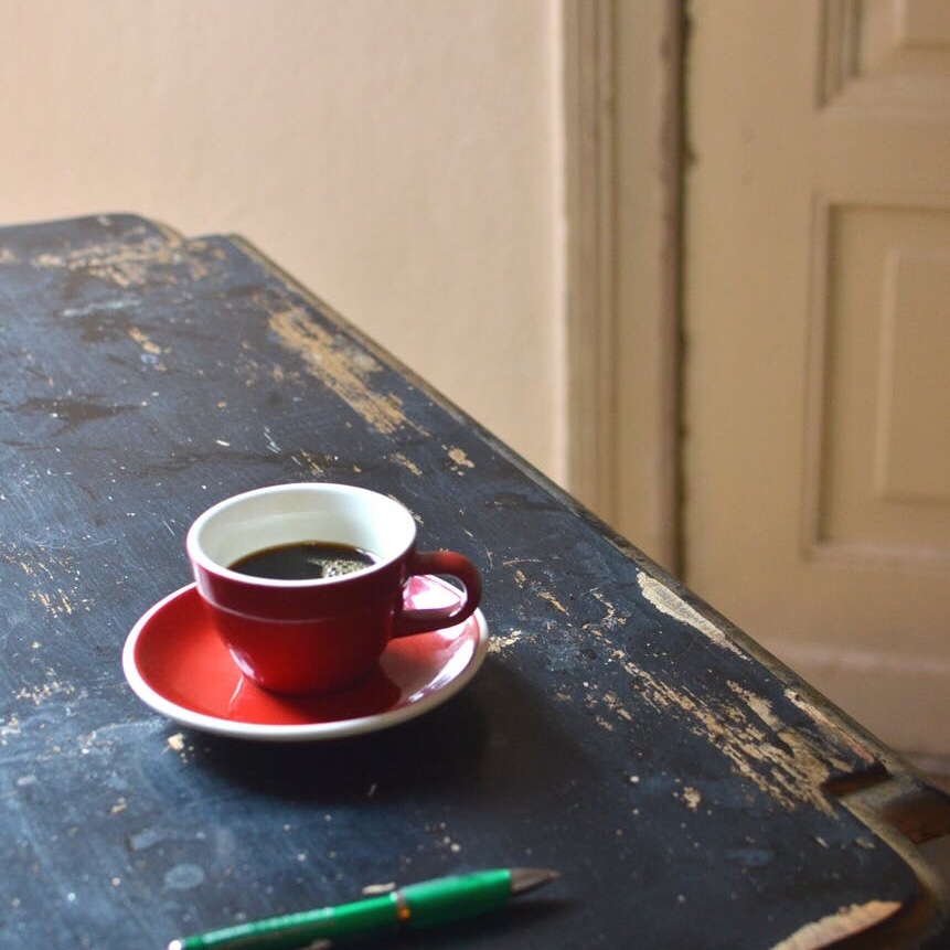 Red coffee cup on a wooden table